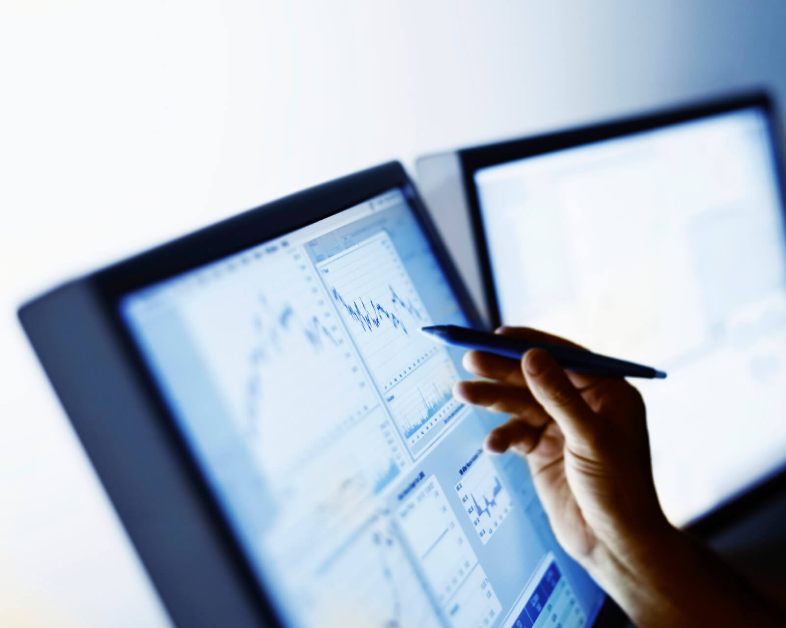 Businessman With Stylist Looking At Stock Market Charts And Graphs.
